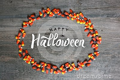 Happy Halloween Calligraphy With Candy Corn Oval Border Over Rustic Wooden Background, Horizontal