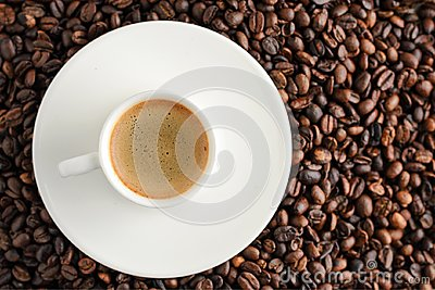 coffee cup espresso on coffee beans backgroun. top view