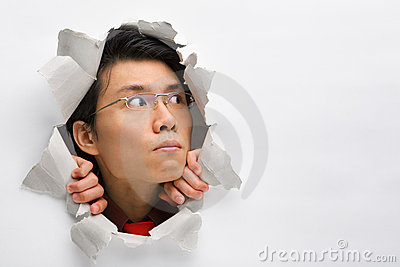 Man in wall looking away to left side