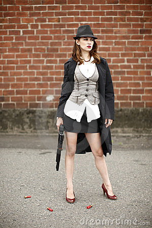 Stylish woman with shotgun