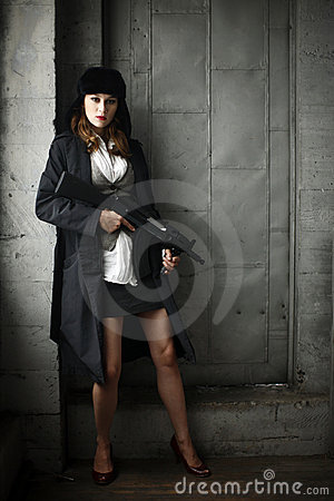 Stylish woman with rifle