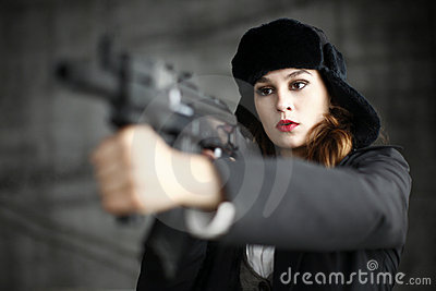 Stylish woman pointing rifle