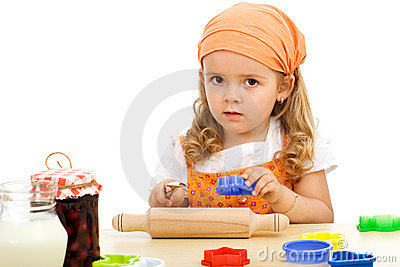 Little girl preparing to make cookies