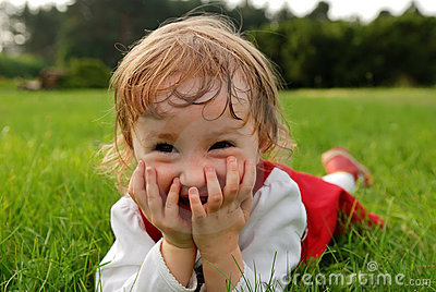 Girl laughing with hands on the mouth