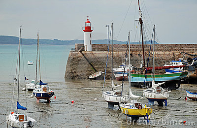 Lighthouse harbor and boats