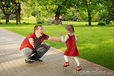 Man playing with little girl