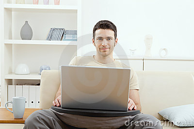 Man using laptop at home