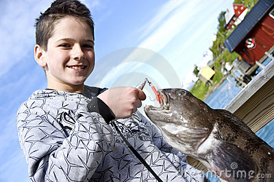 Boy and fishing trophy