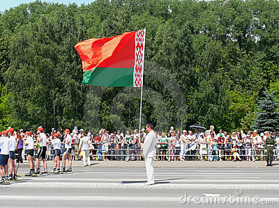 Man holds national flag of Belarus