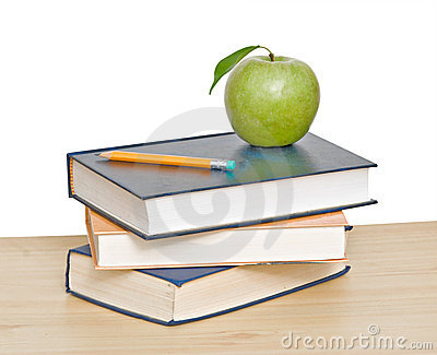 Apple and pencil on top of books