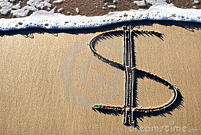 Dollar sign  on sand