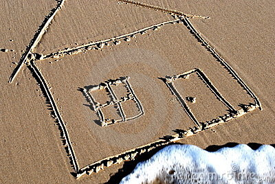 Picture of a house drawn in the sand