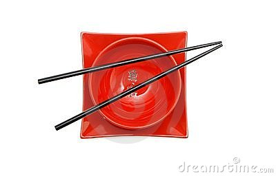 Black chopsticks on red bowl and square plate iso