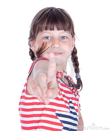 Cute little girl point her finger at someone