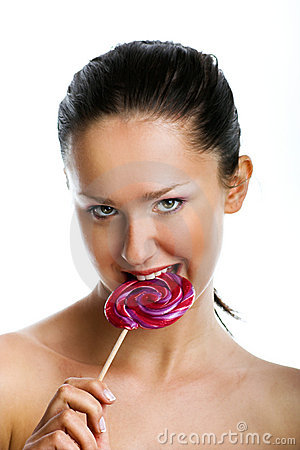 Smiling woman with a lollipop