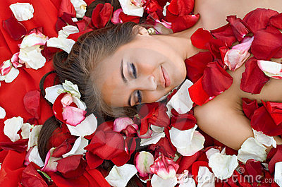 Sleeping girl in rose petal