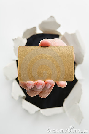 Hand breakthrough wall holding empty golden card