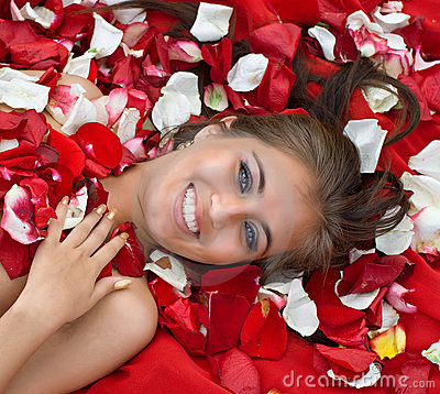 Smiling young girl in rose petal