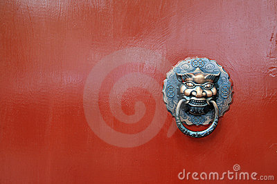 Chinese   lion on red door
