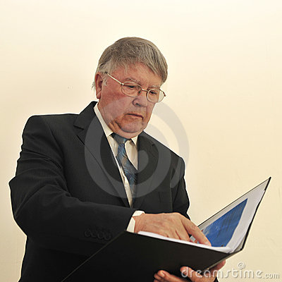 Businessman looking at open folder