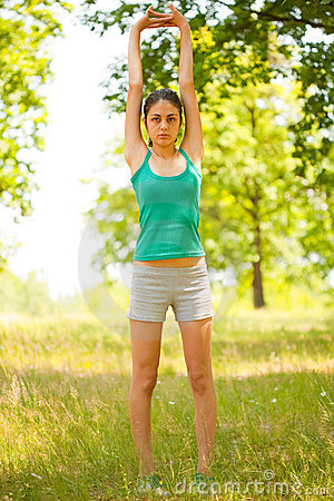 Young woman doing aerobics outdoor