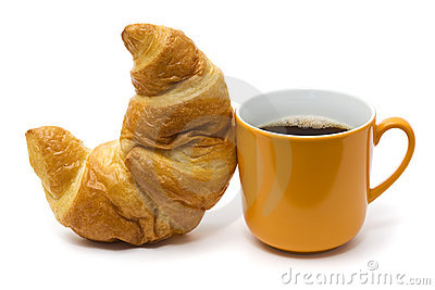 Croissant and coffee isolated on white