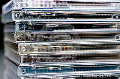 A close up of a stack of CDs