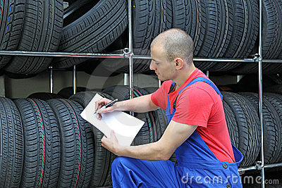 Worker in a tire workshop