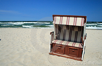 Wicker chair on the beach