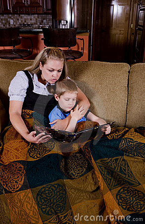 Mom reading a book to her child
