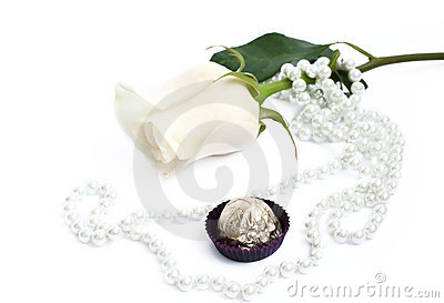 Romantic background with rose, sweets and pearl