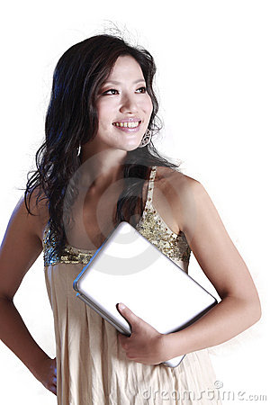 Woman holding a laptop.