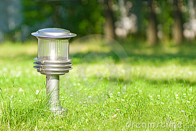 Lantern in the middle of a lawn