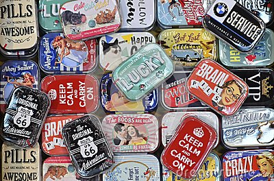Colorfull metal tin box with vintage advertising
