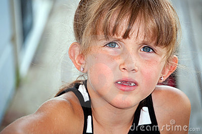 Little girl with questioning look