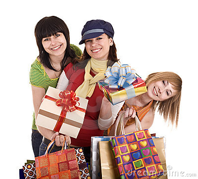 Three beautiful girlfriends enjoy shopping.