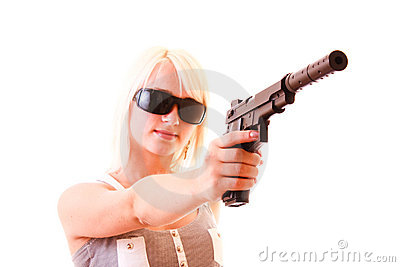 Beautiful woman aiming with gun isolated