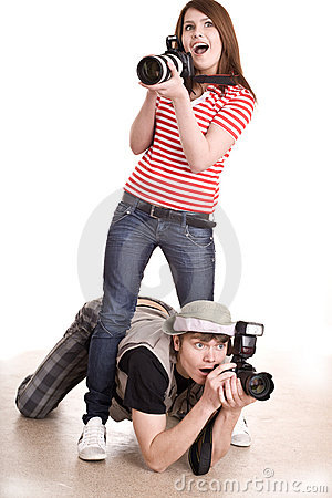 Photographer couple with digital camera.