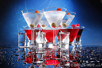 Red and white party cocktails on blue