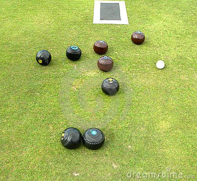 Bowls, jack, and mat lying on bowling green