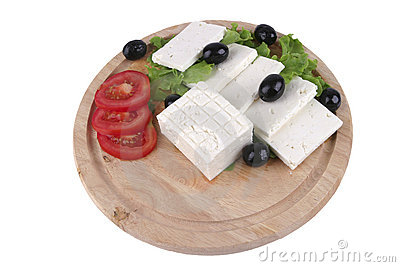 Soft cheese with olives on plate