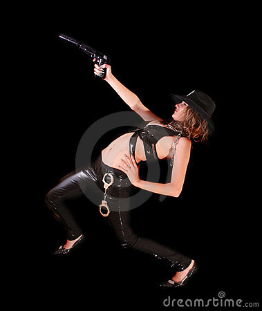 Beautiful woman aiming with gun on black
