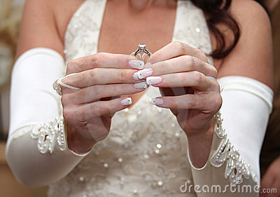 Bride holds engagement ring