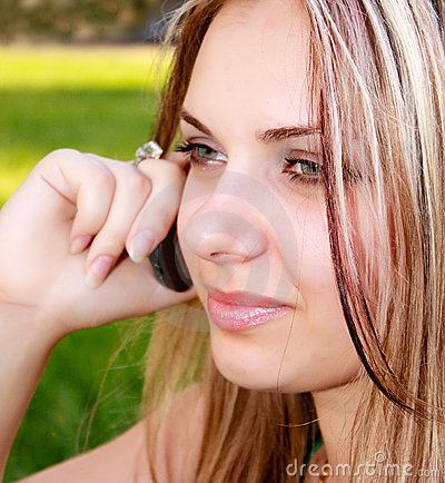 Beautiful woman speaking with mobile phone