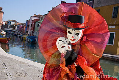 Clown in front of canal on Burano Island