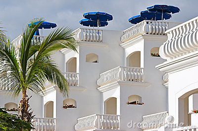 White villa with sunshades