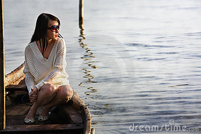Lonely lady on boat looking sunrise