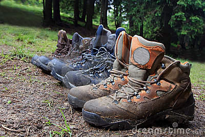 Tourists boots in forest camp
