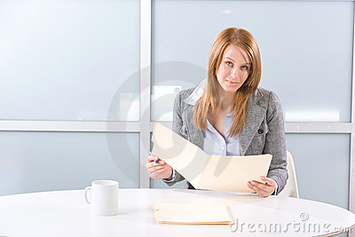 Business woman holding legal documents
