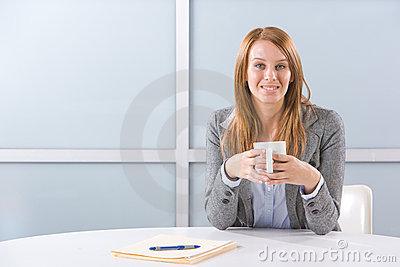 BUsiness woman having coffee
